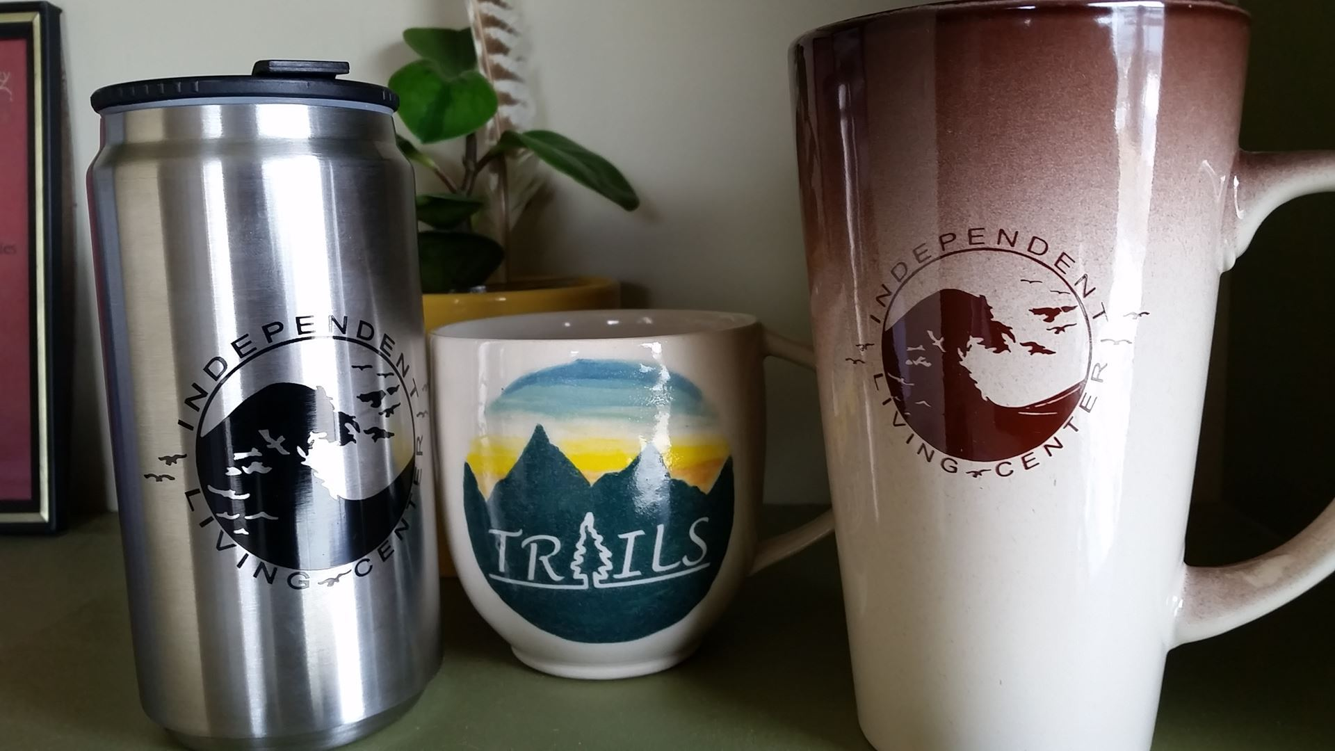 Photo of coffee cups with TRAILS and ILC Logos